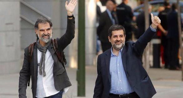 Jordi Cuixart y Jordi Sánchez a su llegada este lunes a la Audiencia Nacional