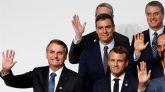 El presidente del Gobierno español, Pedro Sanchez (c); el presidente de Brasil, Jair Bolsonaro (i), y el presidente de Francia, Emmanuel Macron (d), posan este viernes durante el primer día de la Cumbre del G20 en Osaka (Japón).
