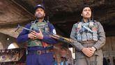 Policías afganos montan guardia cerca de un colegio electoral, este sábado.