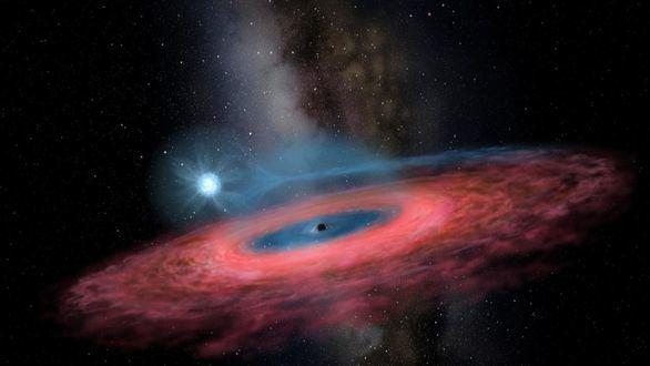 Recreación artística del agujero negro estelar LB-1 con una estrella orbitando a su alrededor.