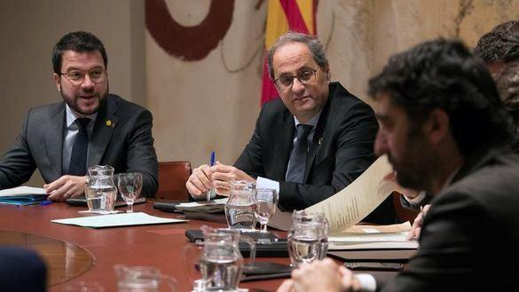 Pere Aragonès, junto a Quim Torra, este martes.
