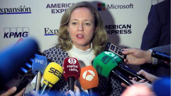 Calviño dice no tener prisa por vender la participación en CaixaBank-Bankia