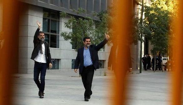 Jordi Cuixart y Jordi Sánchez a su llegada a la Audiencia Nacional este lunes